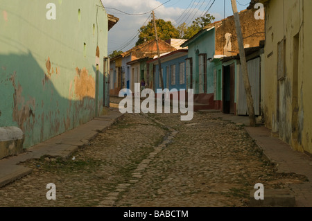 Street scene in the colonial town of Trinidad, Cuba with cobblestones and old houses. - Stock Photo