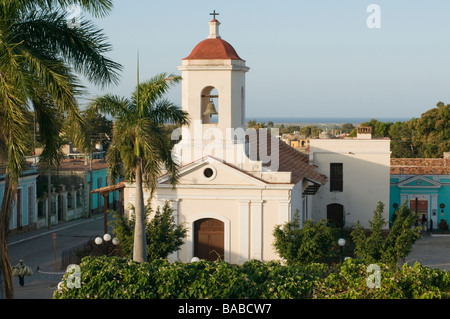 Colonial style church on a major square in the 16th century city of Trinidad, Cuba. - Stock Photo