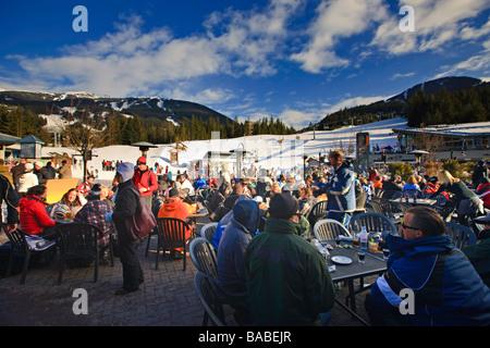 Patrons at an apres-ski bar,Whistler Mountain,Canada. - Stock Photo