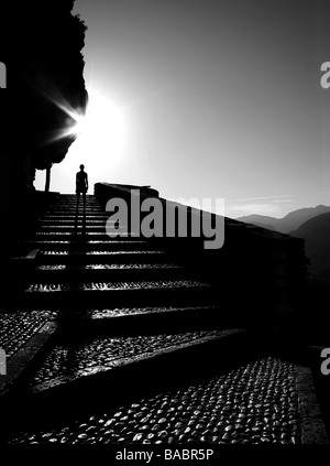 Silhouetted figure on staircase - Stock Photo