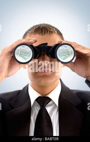 successful businessman looking at currency text - Stock Photo