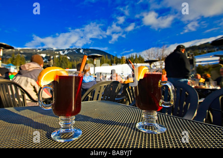 Glasses of mulled wine served at an apres-ski bar,Whistler Mountain,Canada. - Stock Photo