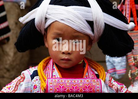 China, Guizhou Province, Longjia village, Long Horn Miao girls in traditional costumes celebrating the Flower Dance - Stock Photo