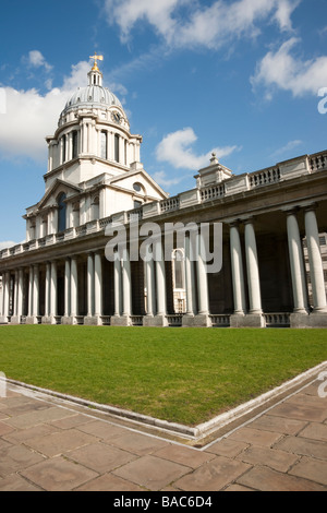 Royal Naval College in Greenwich London against dramatic blye sky with white clouds - Stock Photo