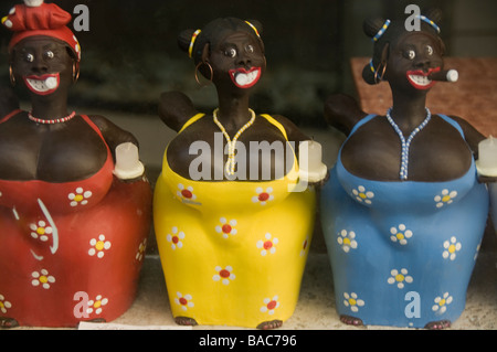 Three candle holders in a shop window in the shape of the Cuban women with cigars in Havana Vieja. - Stock Photo