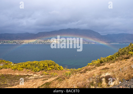 Rainbow over Loch Carron in the West Highlands of Scotland on a showery April day with the settlement of Lochcarron - Stock Photo
