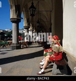 Traditionally dressed girls in the Cloth Hall at the Main Market Square, Cracow, Poland - Stock Photo