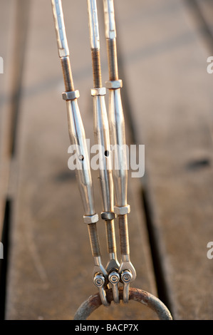 three stainless steel screw threaded adjustable tension bolts rods - Stock Photo
