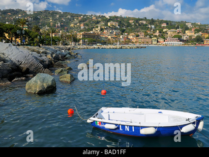 A fishing boat in front of the shoreline in the pictures town of Santa Margherita Ligure, Liguria, Italy. - Stock Photo