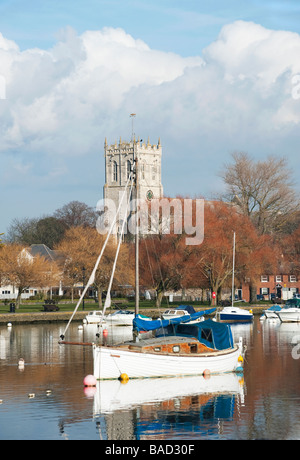 View of Christchurch Priory across the River Stour, Christchurch, Dorset - Stock Photo