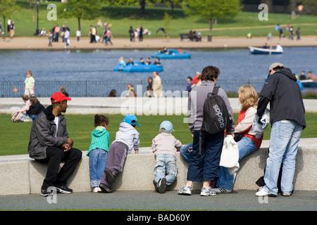 Family at Diana Princess of Wales Memorial Fountain - Hyde Park  - London - Stock Photo