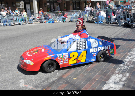 Shriners in miniature cars in Strawberry Festival Parade Plant City Florida - Stock Photo