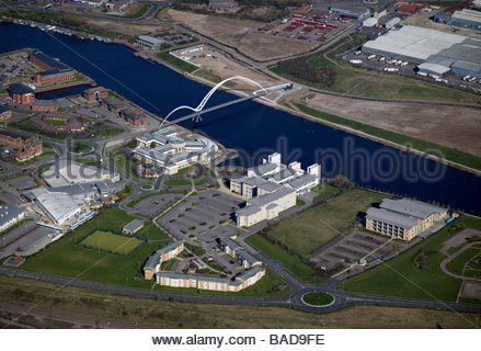 River Tees at Stockton upon Tees, North East England, showing the new Infinity pedestrian bridge and Queens University - Stock Photo