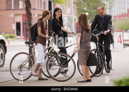 Friends Talking on Way to Work - Stock Photo