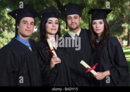 Portrait of College Graduates - Stock Photo