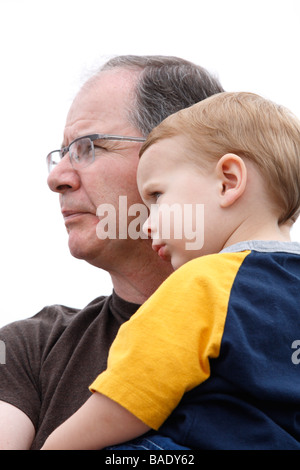 Portrait of a Father Holding His Son - Stock Photo