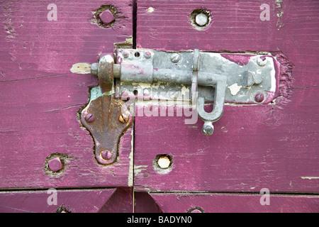 Close-Up of Sliding Bolt Lock on Purple Gate - Stock Photo
