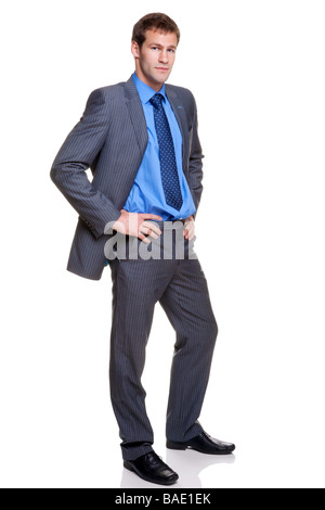 Full length shot of a businessman wearing a grey pinstripe suit isolated on white background - Stock Photo