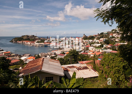 Looking down on the harbour and entrance to St George's the capital of Grenada from the road above - Stock Photo