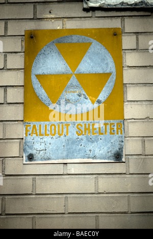 A Fallout Shelter sign circa 1963 on the side of a school in Harlem in New York - Stock Photo