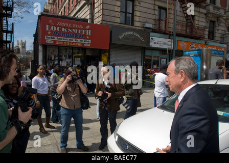 NY Mayor Mike Bloomberg left visits an all hands fire in a laundromat in Harlem in New York - Stock Photo