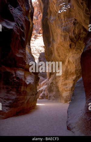 Al-Siq the gorge leading to The Treasury, the most famous building in the ancient city of Petra, Jordan - Stock Photo
