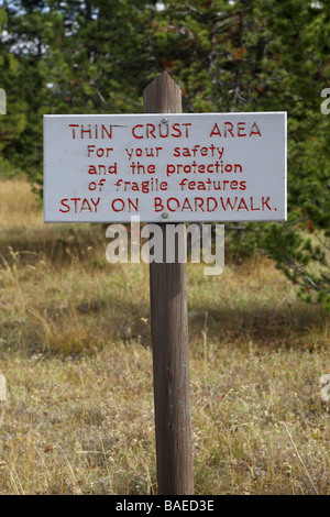 Sign Yellowstone thin crust area stay on boardwalk - Stock Photo