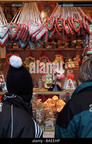 People looking at sweets on a stall at the German Christmas Market, Edinburgh, Scotland, UK - Stock Photo