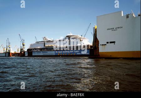 April 20, 2009 - Grimaldi's Grande Africa passes MS Color Magic at Blohm & Voss shipyard in the German port of Hamburg. - Stock Photo