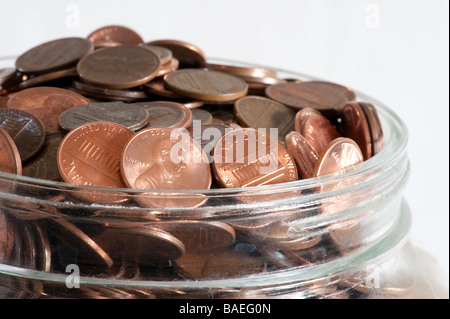 glass jar with pennies - Stock Photo