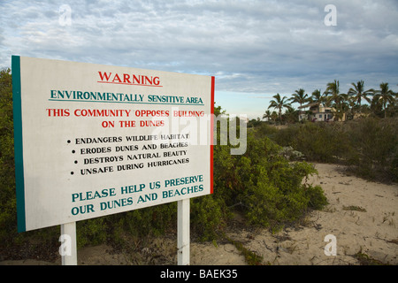 MEXICO Todos Santos Warning sign in English protecting sand dunes from construction and development environmental - Stock Photo