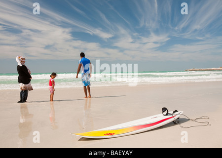 A Muslim arab family on a public beach in Dubai UAE - Stock Photo