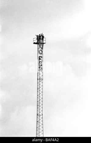 Anti nuclear protesters occupy a weather tower at Hinkley point nuclear power station circa 1984 - Stock Photo