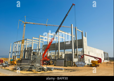 building site construction site factory plant structure skeleton steel girder works new modern building house INVESTMENT - Stock Photo