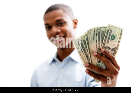 African man smiling and holding money isolated - Stock Photo