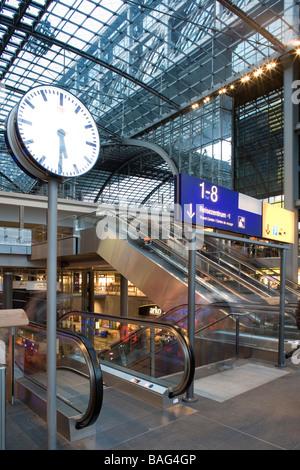 Hauptbahnhof, Berlin, Germany, Gmp von Gerkan Marg + Partner, Hauptbahnhof clock and esculators in main hall. - Stock Photo