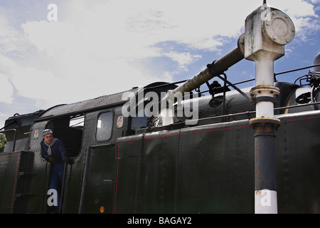 A steam train taking on water Limousin France - Stock Photo