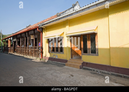 View of a typical street in the old Dutch fort at Galle, Sri Lanka, with antique buildings and artifacts. - Stock Photo