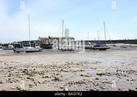 Boats in an empty dry marina at Lyme Regis Dorset UK - Stock Photo