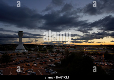 air traffic control tower sunset view with moving clouds across car parks - Stock Photo