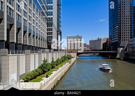 United States, Illinois, Chicago, Loop District, Chicago River, Boeing Building on the left and taxi boat - Stock Photo