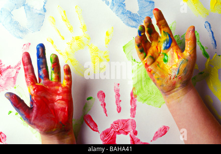 Child s hands covered in paint - Stock Photo