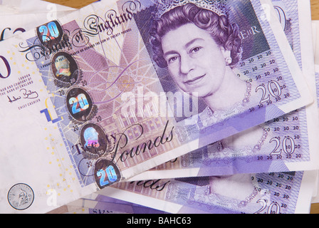 Closeup of piled British money - Stock Photo