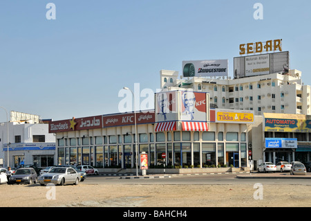 Muscat Kentucky Fried Chicken fast food restaurant with large signs - Stock Photo