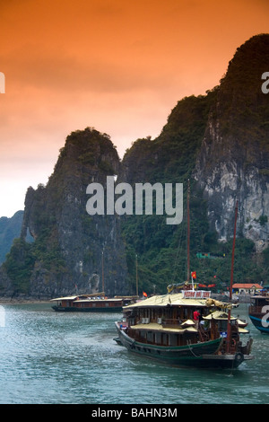 Scenic views of limestone karsts and tourist boats in Ha Long Bay Vietnam - Stock Photo