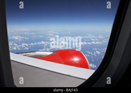Flug ueber den Wolken mit Blick aus dem Fenster xxxxx - Stock Photo