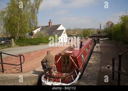 Grindley Brook Whitchurch Shropshire England UK April man in narrowboat in a lock waiting for it to empty on Llangollen - Stock Photo