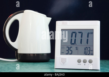 Wireless OWL energy monitor with LCD display showing number of kilowatts of domestic electricity being used with - Stock Photo