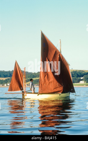 Sailing a Beer lugger boat off Beer village Devon England UK Europe - Stock Photo