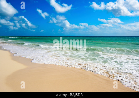 Beautiful beach and waves of Caribbean Sea - Stock Photo